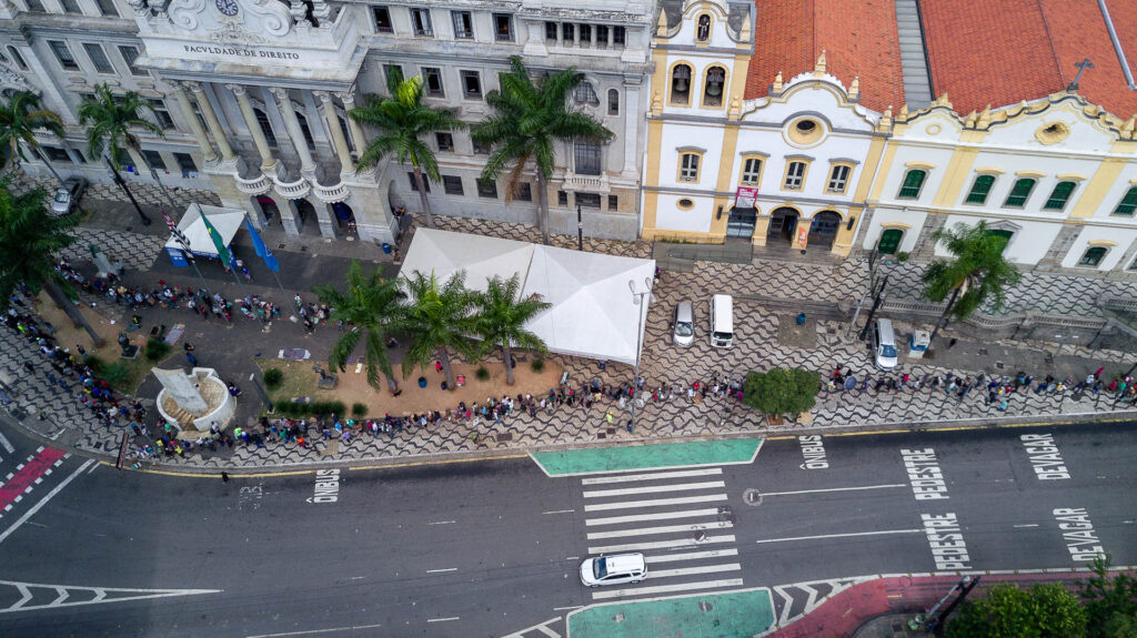 Queue on streets at food distribution in Sao Paolo, Brazil