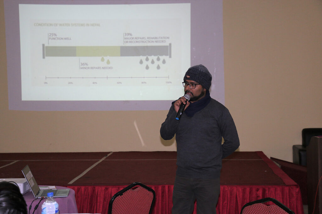 2.Anjil Adhikari presenting the model at the workshop with the Ministry of Water