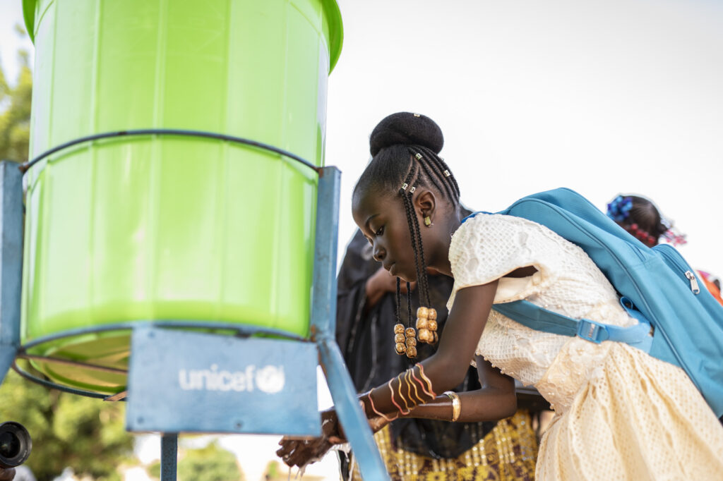 Access to handwashing ensures that Soraya can continue in school.