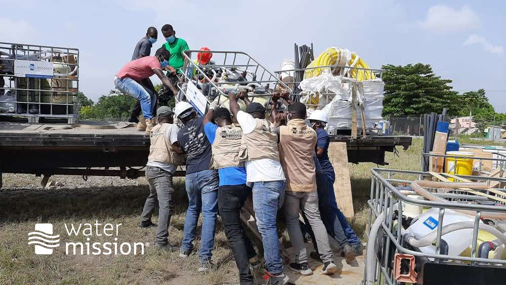 WAter Mission staff transporting safe water systems into the field